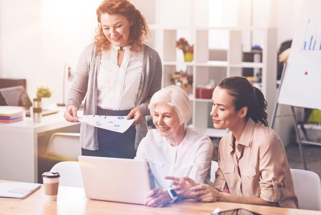 three ladies discussing flexible and phased retirement options